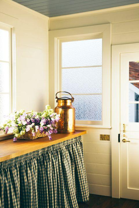 laundry room with gingham skirt