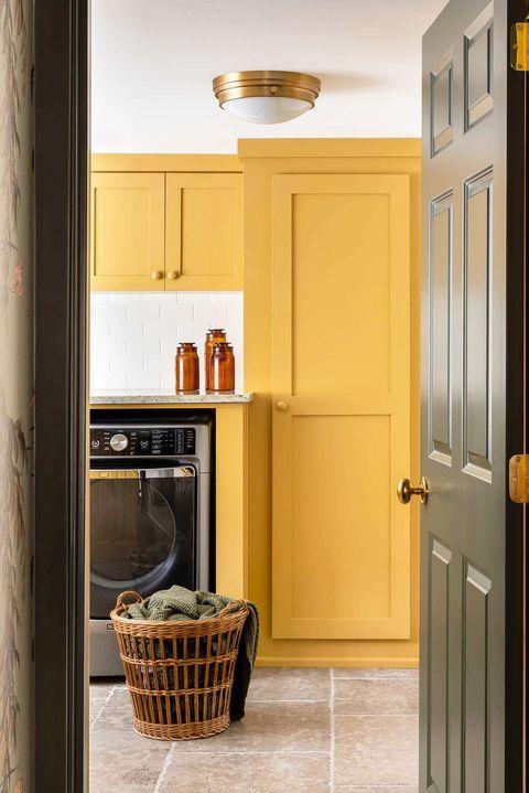 yellow contemporary laundry room